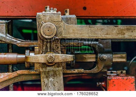 Closeup of greased and heavy mechanical parts of an old steam locomotive