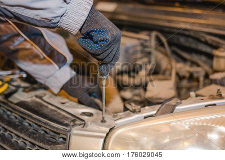 The Man Repairs The Car.