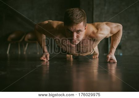 Young Sexy Male Bodybuilder Athlete With A Bare Torso. Portrait Of A Studio Of A Light-skinned Stron