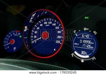 Car dashboard focus on speedometer control panel