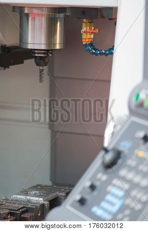 Computer Controlled Industrial Drilling Machine, Close Up, Color Image, Vertical Image