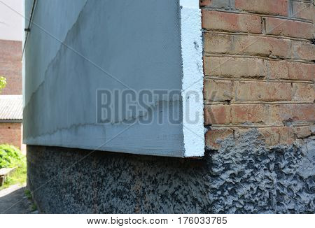 Close up on Brick House Wall Heat Insulation with with Styrofoam Polystyrene with Stucco for House Energy Saving Outdoor