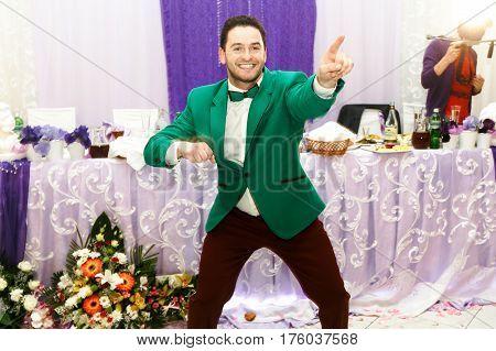Man In Green Jacket Has Fun On A Wedding Dinner