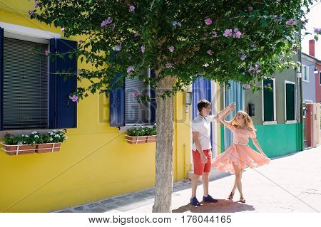 Happy couple dancing in Burano island Venice Italy Europe