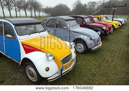 Utrecht Netherlands march 9 2017: Colorful Vintage cars Citroen 2 CV named Duck on parking place Vechten next to motorway A12 in Holland