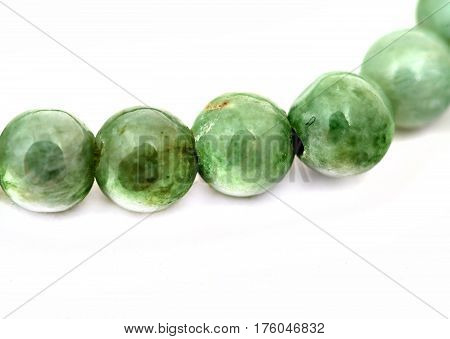 Jade bracelet close-up fragment isolated on white