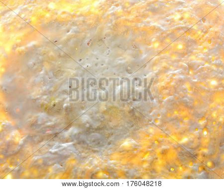 Abstraction from a viscous product. Mucus background on liquid test