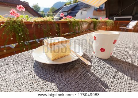 Traditional dessert with cup of coffee on sunny terrace. The image was taken in Bled Slovenia.