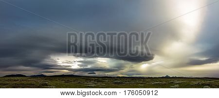 Extreme stormy weather in Iceland with dramatic clouds and moody sky.