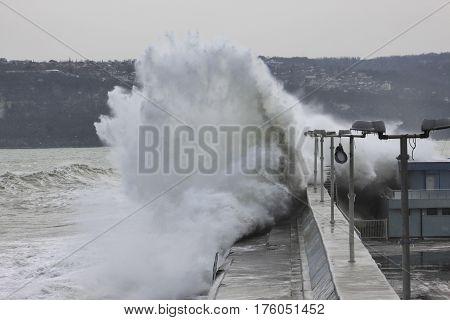 Big waves crashing on breakwater in Varna, Bulgaria