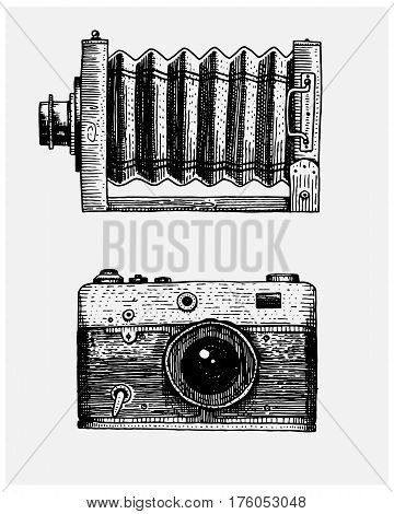 Photo camera vintage, engraved hand drawn in sketch or wood cut style, old looking retro lens, isolated vector realistic illustration.