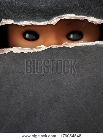 Dark series - a look from darkness. Eyes of spooky doll in paper hole