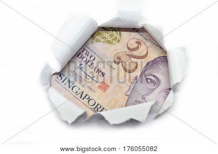 Singapore Currency Peeking Through White Paper