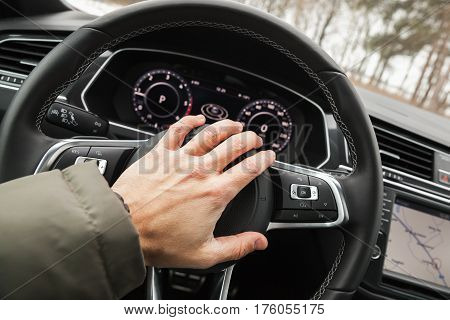 Driver Hand Pushes A Steering Wheel Klaxon
