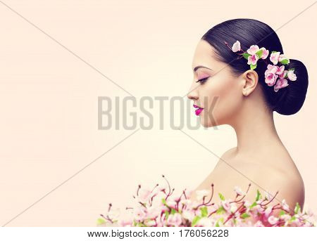 Japanese Girl and Flowers Asian Woman Beauty Makeup Profile Beautiful Fashion Model Side View over Pink Background