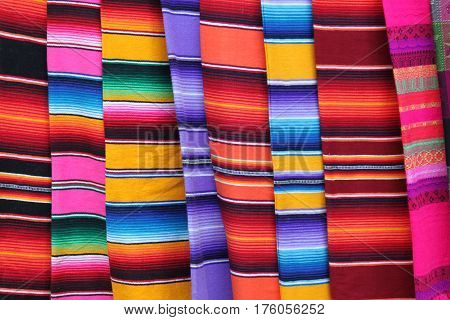 Mexico poncho serape Mexican background rug poncho fiesta cinco de mayo with stripes fabric textile material poster