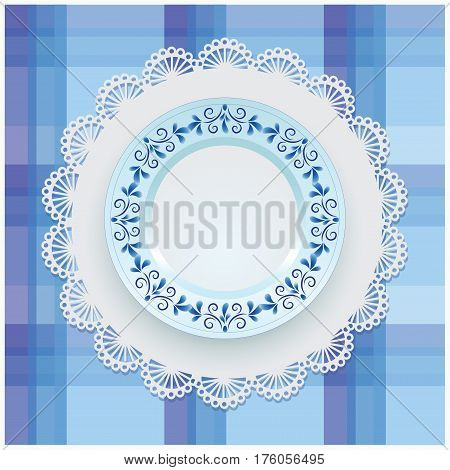 Plate with blue ornament. White porcelain with a pattern round the border. Russian style Gzhel. Lace napkin and checkered background.
