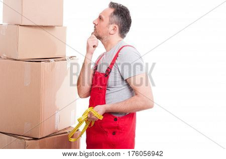 Mover Man Holding Measuring Tape  And Thinking