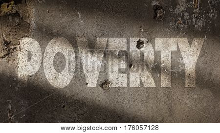 Poverty Written on a Damaged Concrete Wall