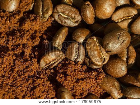 Coffee beans and ground coffee horizontal view bakground extreme macro close up