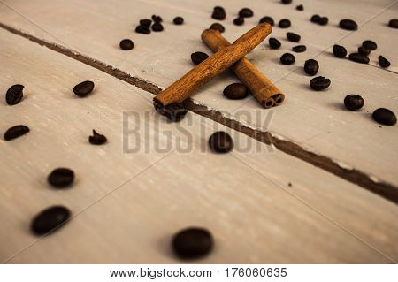 the cinnamon cofee beans on wooden background