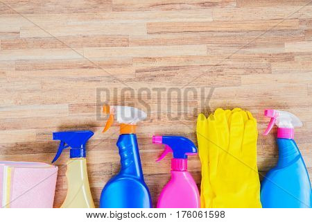Spring cleaning concept - colorful sprays bottles and rubbers border
