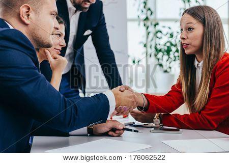 Handshake on usiness meeting, toned image, selective focus