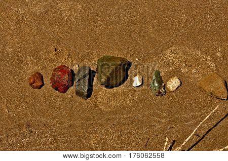 warm stones on the sandy beach in the sun