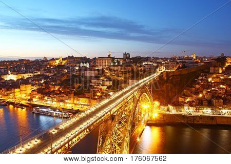 Dom Luis Bridge (Ponte Luis I) and bird eye view of Porto in the evening, Portugal
