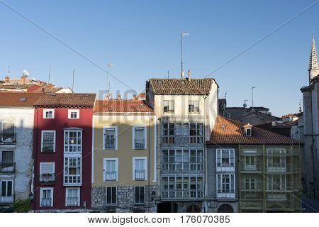 Burgos (Castilla y Leon Spain): exterior of the medieval cathedral in gothic style and buildings with typical verandas