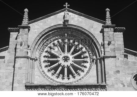 Avila (Castilla y Leon Spain): facade of the historic Santa Teresa church: rose window. Black and white