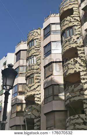 Jaen (Andalucia Spain): buildings with balconies and a street lamp