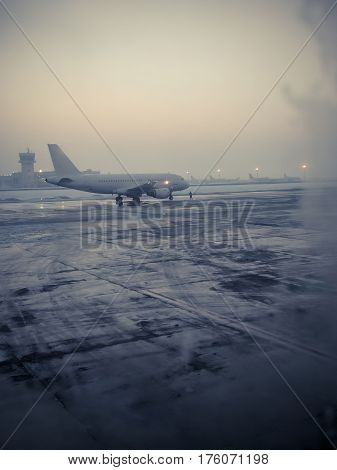 Color shot of a commercial airplane on the runaway on a cold winter morning.