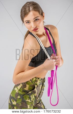 Relaxing Woman Soldier Holding A Rope Elastic