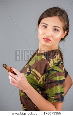 Beautiful Young Woman With A Cigar In Clothes Soldier