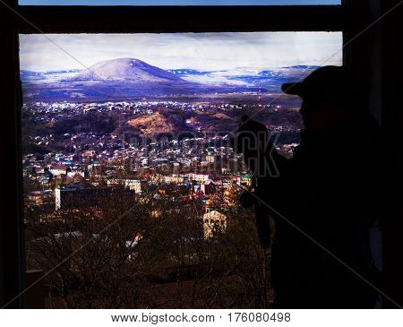 Open window panoramic view to snow mountings