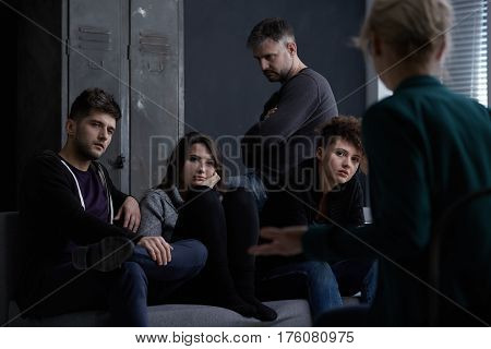 Young people participating in group therapy for alcohol addiction