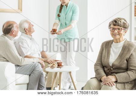Nurse Serving Tea