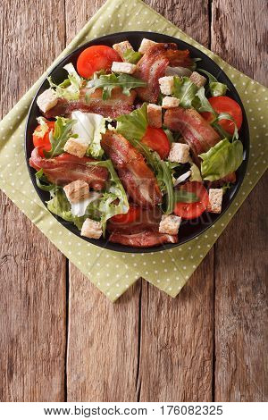 Spicy Salad Of Bacon, Tomato, Croutons And Lettuce Close-up On A Plate. Vertical Top View