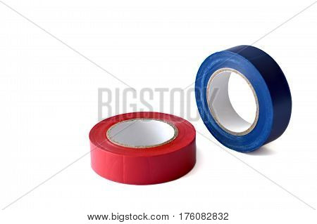 Blue and red insulating tape rolls isolated on white background