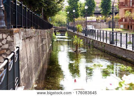 City landscape with a small river. City of Scafati Italy. Architecture of a small southern Italian town.