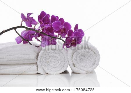 Branch orchid on towel