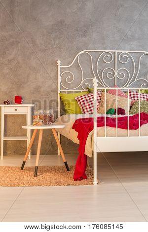 Warm bedroom design with marital bed, vertical view