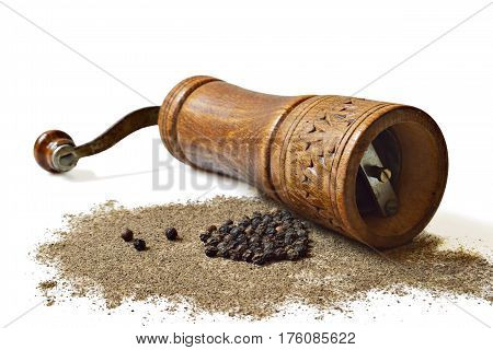 Peppercorn, grinder and grounded pepper isolated on white background