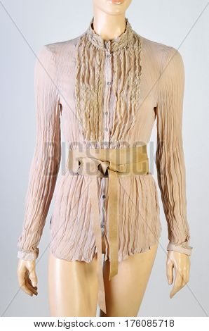 Womens Beige blouse on a mannequin. isolated on gray background