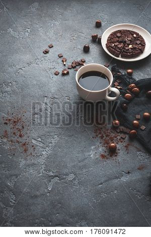 Cups of coffee chocolate cake on dark background. Flat lay top view copy space