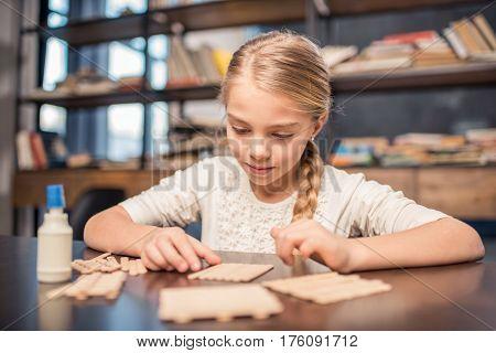 Little Girl Handcrafting