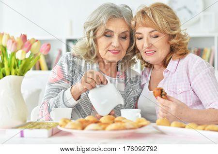 Portrait of two beautiful mature women having breakfast