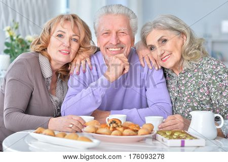 Portrait of three elderly people having breakfast