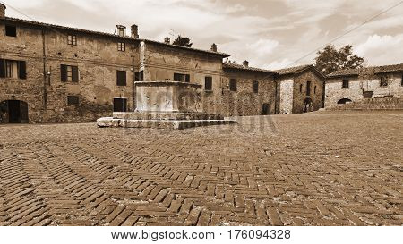 Square in the Medieval City of Gimignano in Italy Vintage Style Sepia